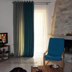 Δίχρωμη κουρτίνα με τρουκ σε τόνουνς του aqua-μπλε σε συνδιασμό με λευκή γάζα.