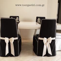 Καλύμματα σε καρέκλες τραπεζαρίας σε μάυρο άσπρο με swarovski στο δέσιμο.